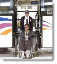 Driver helps person in wheelchair off of bus