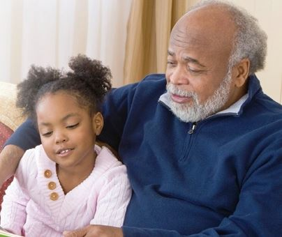 Older Man Reading with Young Girl