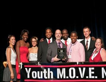 Youth Move Members with Award